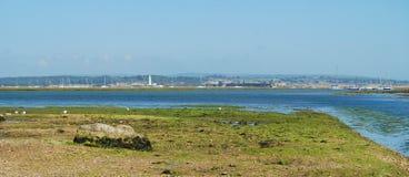Estuary at low-tide. Hurst Castle across estuary from Milford-on -Sea Stock Image
