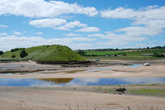 Estuary on river Aln at Alnmouth. Estuary of river Aln and historic cross on hill at Alnmouth Stock Image