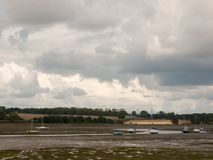 Estuary scene in manningtree with moored boats tide clouds lands Stock Photos