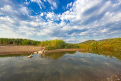Estuary of a small river on a sandy beach, Greece. stock photo