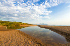 Estuary of a small river on a sandy beach, Greece. Estuary of a small river full of reeds on a sandy beach. Neda river at western Peloponnese, Greece royalty free stock photos