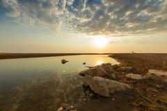 Estuary of a small river on a sandy beach, Greece. Royalty Free Stock Photos