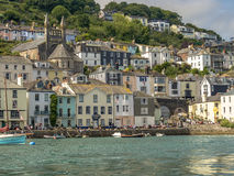 Estuary view of Dartmouth Town Centre. Image of the Houses on The Riverbank at Dartmouth Estuary with boats moored in the foreground royalty free stock photography