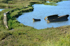 Estuary with wreck and path Stock Photos