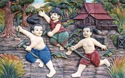 Estuco tailandés de la cultura nativa en la pared del templo Imagen de archivo