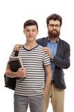 Estudante adolescente com seu pai imagem de stock royalty free