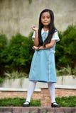 Estudante asiática estando da criança da preparação fotos de stock royalty free