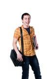 Estudante bonito novo em um fundo branco foto de stock