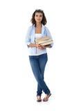 Estudante bonito que guardara livros fotos de stock royalty free