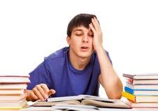 Estudante cansado com os livros imagem de stock royalty free