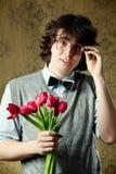 Estudante com flores imagem de stock