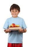 Estudante com fruta e livros foto de stock
