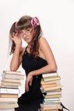 estudante com livros e vidros imagens de stock royalty free