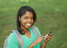 Estudante com telefone esperto fotos de stock royalty free