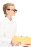 Estudante da escola primária com dobradores Imagens de Stock