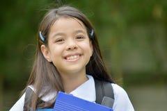 Estudante de sorriso Wearing School Uniform da preparação com cadernos fotos de stock