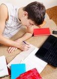Estudante em casa Foto de Stock Royalty Free