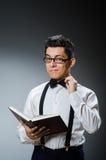 Estudante engraçado com livros Imagem de Stock Royalty Free