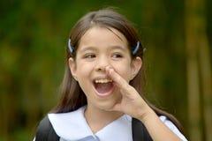 Estudante fêmea asiático novo de fala Wearing Uniform fotografia de stock