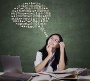 Estudante fêmea com ícones da Web Fotos de Stock