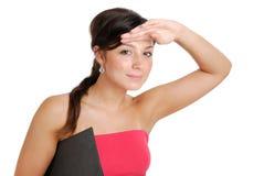Estudante fêmea com a visão académica que olha afastado fotografia de stock