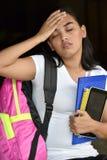 Estudante fêmea With Headache fotos de stock royalty free