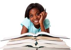 Estudante feliz com trabalhos de casa Imagens de Stock Royalty Free