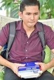 Estudante filipino jovem Smirking do menino imagens de stock