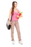 Estudante fêmea que guarda livros Fotos de Stock