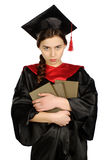 Estudante graduada bonita no envoltório Fotos de Stock Royalty Free