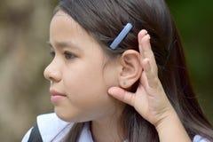 Estudante Hearing Wearing Uniform com cadernos foto de stock