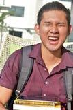 Estudante masculino asiático Laughing imagens de stock royalty free