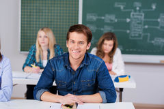Estudante masculino With Female Classmates e professor In Background Fotos de Stock Royalty Free