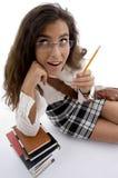 Estudante novo com livros e lápis Imagens de Stock Royalty Free