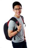 Estudante novo feliz com trouxa Imagens de Stock Royalty Free