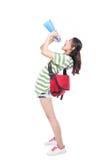 Estudante novo que grita através do megafone Fotografia de Stock