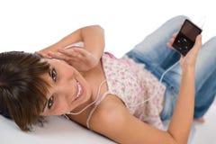 Estudante - o adolescente fêmea feliz escuta a música Fotografia de Stock