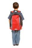 Estudante: Opinião traseira o menino com trouxa Imagens de Stock