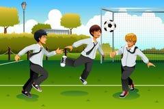 Estudante Playing Soccer Imagem de Stock