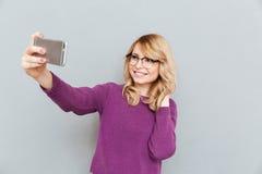 Estudante que faz a foto fotografia de stock royalty free