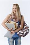Estudante que guarda livros e tabuleta foto de stock royalty free