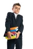Estudante que guarda livros pesados Fotografia de Stock