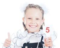Estudante que guarda um sinal com o número em sua mão Foto de Stock Royalty Free