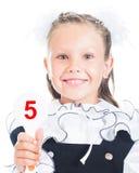 Estudante que guardara um sinal com o número em sua mão Fotografia de Stock Royalty Free