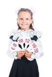 Estudante que guardara um sinal com o número em suas mãos Foto de Stock