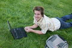 Estudante que usa o portátil Imagens de Stock