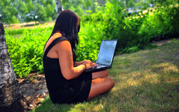 Estudante que usa o portátil Foto de Stock Royalty Free