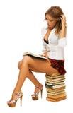 Estudante 'sexy' que faz uns trabalhos de casa Fotografia de Stock Royalty Free
