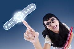 Estudante universitário com uma tecla 'Iniciar Cópias' ao futuro Fotografia de Stock Royalty Free