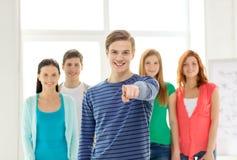 Estudantes com o adolescente em apontar dianteiro em você imagem de stock royalty free